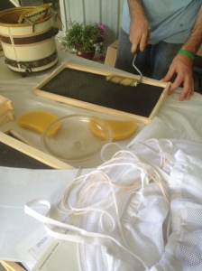 rolling melted wax onto frames